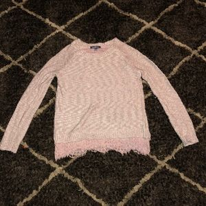 A pale pink lace detail sweater